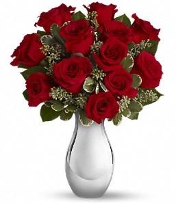 Giresun çiçek gönderme sitemiz güvenlidir   vazo içerisinde 11 adet kırmızı gül tanzimi