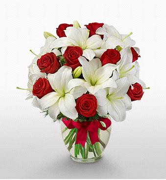 Giresun kaliteli taze ve ucuz çiçekler  1 dal kazablanka 11 adet kırmızı gül vazosu